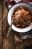 Italiensk bukragu med tomater Royaltyfri Bild
