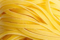 Italiensk närbild för pastaFettuccinebakgrund Arkivfoton