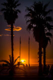 Italiensk solnedgång och strand Arkivfoto