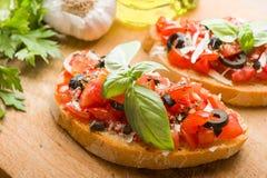 Italienska Bruschetta med tomater Fotografering för Bildbyråer