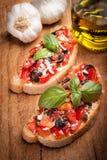 Italienska Bruschetta med tomater Arkivfoto