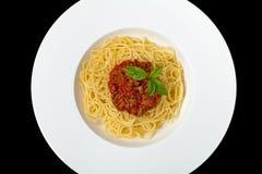 italienska matlagningmatingredienser bolognese spagetti Arkivbild