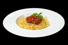 italienska matlagningmatingredienser bolognese spagetti Arkivbilder