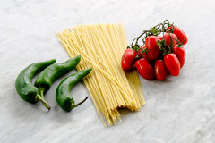 Italienska spagettitomater och peppar Fotografering för Bildbyråer