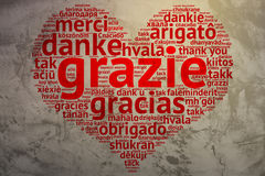 Italin: Grazie, Heart shaped word cloud Thanks, Grunge Backgroun Stock Image