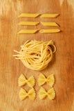 Italina pastas. Italian pastas choise : penne, pici, fafalle Royalty Free Stock Photography