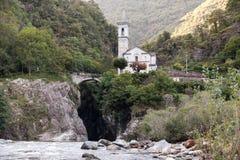 Italy Alps. ItalyCanobio, Small church on a river in the Alps Stock Image