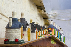 Italy, Apulia, Alberobello, trulli, typical houses. Souvenir. Alberobello: souvenirs, trulli colored sorted and exposed outside the shops Stock Image