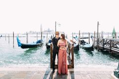 Italy beauty, pretty girl and boy with San Giorgio Maggiore and boat behind, Venezia, Venice.  stock photography