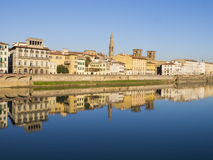 Italy, buildings of Florence reflected in Arno river. Italy, buildings of Florence reflected in the water of Arno river Royalty Free Stock Image