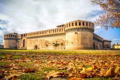 Italy castle autumn leaves ground park yellow tone background me Stock Photos