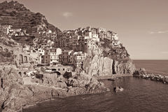 Italy. Cinque Terre. Manarola village. In Sepia toned. Retro sty Stock Photo