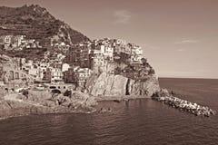 Italy. Cinque Terre. Manarola village. In Sepia toned. Retro sty Stock Photos
