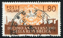 Symbols of Industry. ITALY - CIRCA 1956: stamp printed by Italy, shows Arms of Republic and Symbols of Industry, circa 1956 royalty free stock photos