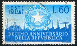 Symbols of Industry. ITALY - CIRCA 1956: stamp printed by Italy, shows Arms of Republic and Symbols of Industry, circa 1956 stock photography