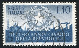 Symbols of Industry. ITALY - CIRCA 1956: stamp printed by Italy, shows Arms of Republic and Symbols of Industry, circa 1956 stock photo