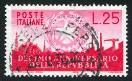 Symbols of Industry. ITALY - CIRCA 1956: stamp printed by Italy, shows Arms of Republic and Symbols of Industry, circa 1956 royalty free stock images