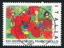 Children and red balloons. ITALY - CIRCA 1979: stamp printed by Italy, shows Children and red balloons by children drawing, circa 1979 stock photos
