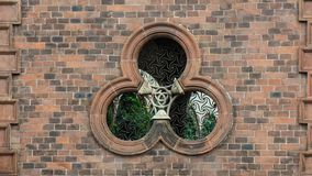 Round window on building facade of church. Italy city trip to milan round window on building facade of church stock photography