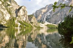 The wonderful Braies lake in the Dolomites in spring with the mountains still covered in snow. Italy is a country with many wonderful places and the Dolomites Royalty Free Stock Image