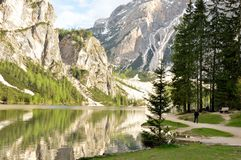 The wonderful Braies lake in the Dolomites in spring with the mountains still covered in snow. Italy is a country with many wonderful places and the Dolomites Royalty Free Stock Photography