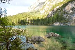 The wonderful Braies lake in the Dolomites in spring with the mountains still covered in snow. Italy is a country with many wonderful places and the Dolomites Stock Photography