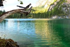 The wonderful Braies lake in the Dolomites in spring with the mountains still covered in snow. Italy is a country with many wonderful places and the Dolomites Stock Photo