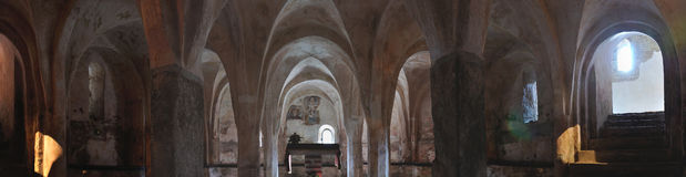 Italy, crypt of romanesque church panorama. Crypt panorama of italian romanesque church Royalty Free Stock Images
