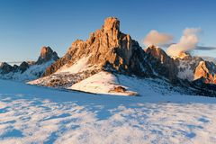 Italy, Dolomites, Alps - wonderful scenery, above the clouds at beautiful day in winter with first snow, Italy. Giau pass in autumn with first snow, Dolomites royalty free stock photos