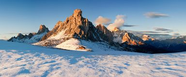 Italy, Dolomites, Alps - wonderful scenery, above the clouds at beautiful day in winter with first snow, Italy. Giau pass in autumn with first snow, Dolomites royalty free stock images