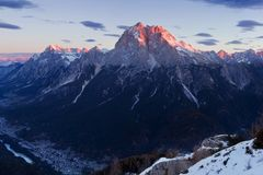 Italy, Dolomites, Alps - wonderful scenery, above the clouds at beautiful day in winter with first snow, Italy. Monte Antelao. In autumn with first snow royalty free stock photos