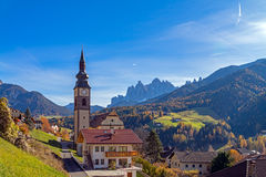 Italy. Dolomites. Autumn landscape with bright colors, house and larch trees Royalty Free Stock Photography