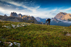 Italy, Dolomites - Male hiker photographers make the best pictures at dawn Royalty Free Stock Images