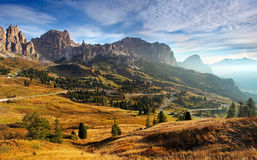 Italy Dolomites moutnain at sunrise. Road to passo gardena Royalty Free Stock Photos
