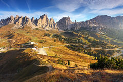 Italy Dolomites moutnain at sunrise. Road to passo gardena Royalty Free Stock Images