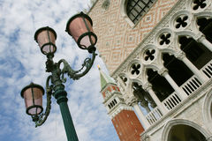 Italy. Ducal Palace. Fragment of the bell tower and Doge's Palace Stock Photos
