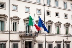 Italy and the European union flag on a building Royalty Free Stock Photography