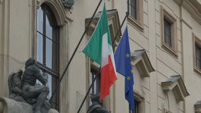 Italy and European Uninon Building Flag. Italy and European Union Flags toghether on an embassy building stock video footage