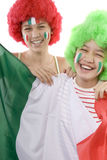 Italy fans. With a flag and face painting Stock Photos