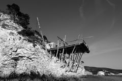 Italy: the fishermans house. Trabucco. Now forgotten, ruined by the waves of the sea, the fishermans house still stands there and reminds us of the difficulties Stock Photography