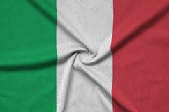 Italy flag is depicted on a sports cloth fabric with many folds. Sport team banner. Italy flag is depicted on a sports cloth fabric with many folds. Sport team royalty free stock images