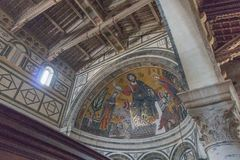 The medieval mosaic of Christ between the Virgin and St Minias in Basilica San Miniato al Monte, Florence, Tuscany, Italy stock images