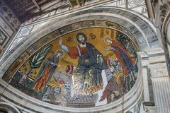 The medieval mosaic of Christ between the Virgin and St Minias in Basilica San Miniato al Monte, Florence, Tuscany, Italy royalty free stock photography