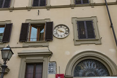 Italy. Florence, the beautiful facade with clock of the old European house. Stock Photo