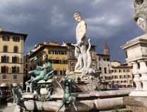 Italy. Florence city streets. Fountain of Neptune in Piazza della Signoria. Piazza della Signoria is an L-shaped square in front of the Palazzo Vecchio in Stock Photos