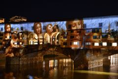 Italy, Florence, December 2018: The famous Ponte Vecchio of Florence illuminated in occasion of F-Light - Festival of Lights. With the masterpieces of Leonardo royalty free stock image
