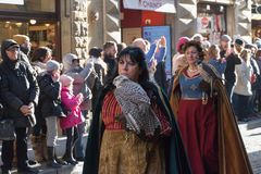 Women in medieval costume holding predatory birds at traditional parade of Epiphany Befana medieval festival in Florence, Tuscany, Royalty Free Stock Images