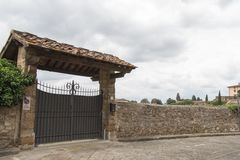 Entrance gate to typical Italian villa house, Florence, Italy stock photos