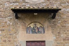 Mosaic above the entrance of Saint Leonardo in Arcetri Church. Florence, Italy royalty free stock photography