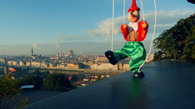 Italy Florence playing puppet Pinocchio in front of city landscape